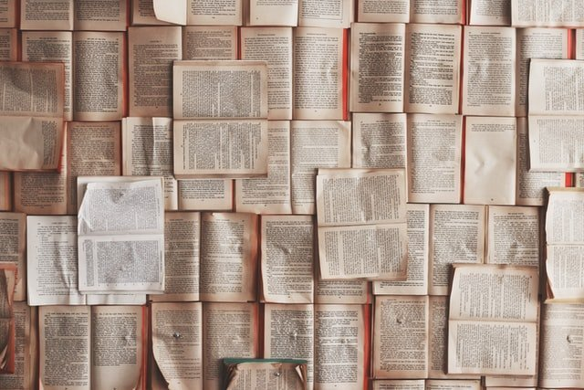 Storybooks laid open to form a carpet of pages